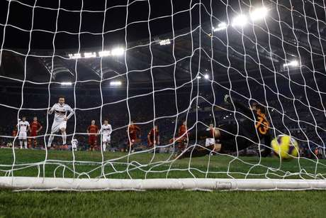 AC Milan's Gianpaolo Pazzini scores a penalty against AS Roma.