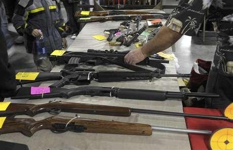 A dealer displays firearms for sale at a gun show in Kansas City, Missouri December 22, 2012.