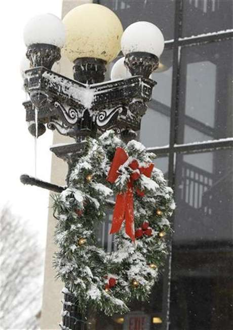 A Christmas wreath is covered with snow on West 4th Street in Waterloo, Iowa, December 20, 2012.