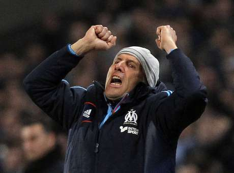 Olympique Marseille's head coach Elie Baup reacts at the end of his French Ligue 1 soccer match against Saint Etienne at the Velodrome stadium in Marseille December 23, 2012.