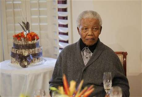Former South African president Nelson Mandela looks on as he celebrates his birthday at his house in Qunu, Eastern Cape July 18, 2012.