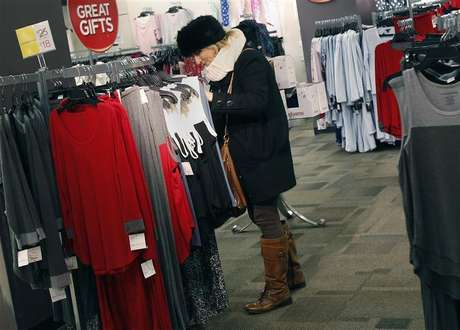 A woman shops for jeans at a J.C. Penney store in New York November 27, 2012.