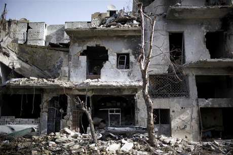 Damaged houses are seen in Aleppo December 24, 2012.
