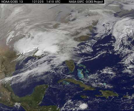 Storm clouds are seen on the east coast of the United States in this NASA handout satellite image taken at 1415 GMT, December 25, 2012. A strong winter storm was expected to bring a white Christmas morning to millions of Americans Tuesday - but also high winds and even the risk of tornadoes for some.