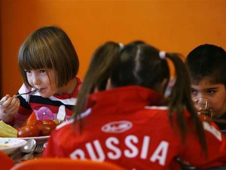 Orphan children have a meal at an orphanage in the southern Russian city of Rostov-on-Don.