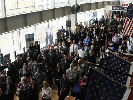 Job applicants listen to a presentation prior to the opening of a job fair for veterans and their spouses held by the U.S. Chamber of Commerce.<br />