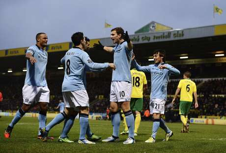 Edin Dzeko celebrates one of his two goals which led the way for Manchester City to defeat Norwich.