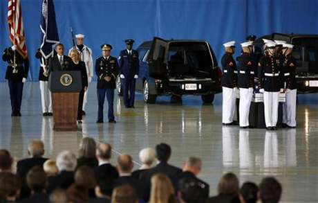 U.S. President Barack Obama and Secretary of State Hillary Clinton participate in a transfer ceremony of the remains of U.S. Ambassador to Libya, Chris Stevens and three other Americans killed this week in Benghazi, at Andrews Air Force Base near Washington, September 14, 2012. Ambassador Stevens and the other Americans died after gunmen attacked the lightly fortified U.S. consulate and a safe house refuge in Benghazi on Tuesday night.