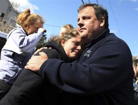 New Jersey Governor Chris Christie comforts Kerri Berean whose home was damaged by Hurricane Sandy in Little Ferry, New Jersey, November 3, 2012 in this handout image courtesy of the governor's office.