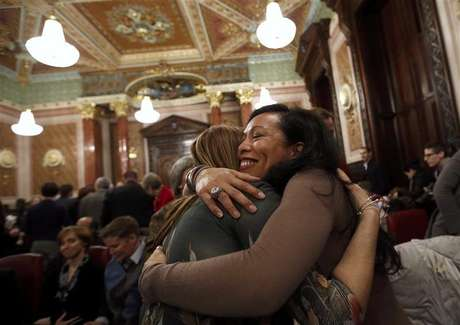Mercedes Santos (R) hugs her partner of 21 years, Theresa Volpe, after a vote in a Committee hearing at the Illinois State Capital in Springfield, Illinois, January 3, 2013. Illinois could become the next U.S. state to legalize gay marriage.