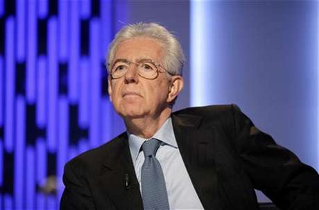 "Italy's outgoing Prime Minister Mario Monti poses before the taping of the talk show ""Otto e mezzo"" (Eight and a half) at La7 television in Rome January 4, 2013."