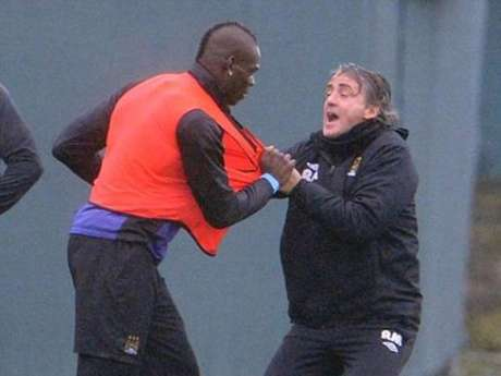 Roberto Mancini and Mario Balotelli in training.