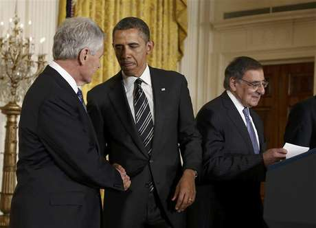 U.S. President Barack Obama (C) greets his Defense Secretary-nominee, former U.S. Senator Chuck Hagel, as current Defense Secretary Leon Panetta (R) takes the podium prior to the president anouncing Hagel's nomination at the White House in Washington January 7, 2013.