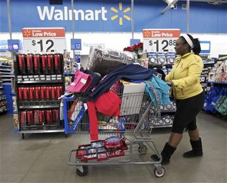 Tasha heads to checkout at a Walmart Store in Chicago, November 23, 2012.