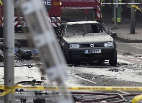 A damaged car is surrounded by debris from a crashed helicopter in Vauxhall, London January 16, 2013.