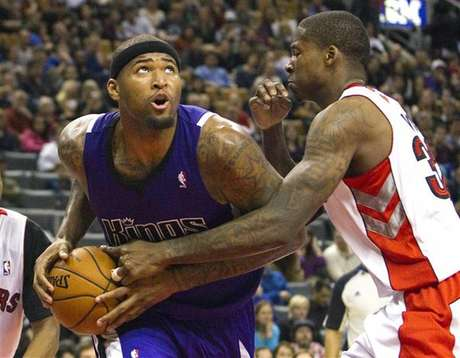 Sacramento Kings' DeMarcus Cousins drives to the basket past Toronto Raptors' Ed Davis (R) in the second half of their NBA basketball game in Toronto January 4, 2013.