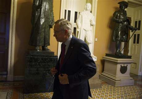 U.S. Senate Majority Leader Harry Reid (D-NV) walks to his office at the U.S. Capitol after returning from a meeting with President Barack Obama at the White House in Washington December 28, 2012.
