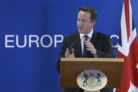 Britain's Prime Minister David Cameron holds a news conference during a European Union leaders summit, in Brussels December 14, 2012.