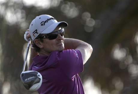Justin Rose of England watches his shot from the ninth tee during the second round of the Abu Dhabi Golf Championship at the Abu Dhabi Golf Club January 18, 2013.
