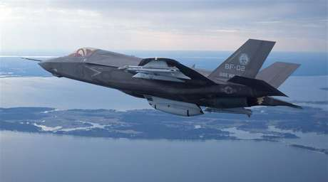 The U.S. Marine Corps version of Lockheed Martin's F35 Joint Strike Fighter, F-35B test aircraft BF-2 flies with external weapons for the first time over the Atlantic test range at Patuxent River Naval Air Systems Command in Maryland in a February 22, 2012 file photo.