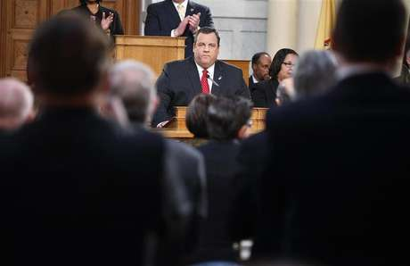 New Jersey Governor Chris Christie receives a standing ovation as he gives his State of the State address in the assembly chamber in Trenton, New Jersey, January 8, 2013.