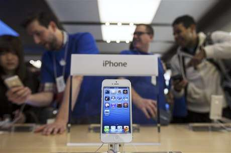 An Apple iPhone 5 phone is displayed in the Apple Store on 5th Avenue in New York, September 21, 2012.