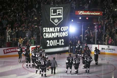 Los Angeles Kings players watch as their Stanley Cup championship banner is raised at the Staples Center before their NHL hockey game against the Chicago Blackhawks in Los Angeles, California, January 19, 2013.
