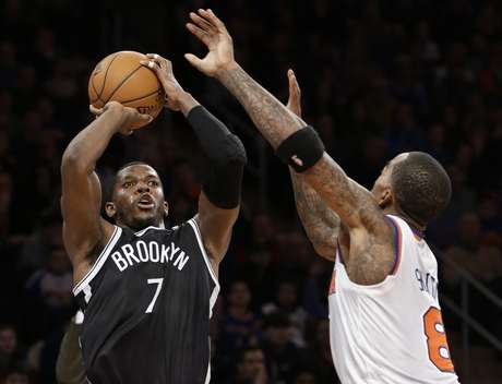 "Brooklyn Nets guard <font color=""red"">Joe</font> <font color=""red"">Johnson</font> (7) shoots a 3-pointer over New York Knicks guard J.R. Smith (8) in the second half of their NBA basketball game at Madison Square Garden in New York, Monday, Jan. 21, 2013. The Nets won 88-85."