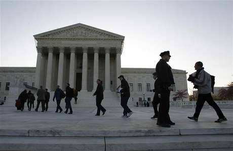 Members of the public who received tickets enter into the Supreme Court in Washington, March 27, 2012.