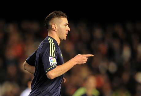 Karim Benzema of Real Madrid CF celebrates after scoring his team's opening goal during the Copa del Rey Quarter Final, 2nd leg match between Valencia CF and Real Madrid CF at estadio Mestalla on January 23, 2013 in Valencia, Spain.
