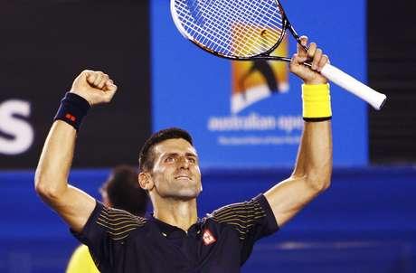 Novak Djokovic of Serbia celebrates defeating.