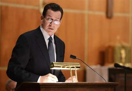 Dannel Malloy, Governor of Connecticut speaks to mourners gathererd inside the St. Rose of Lima Roman Catholic Church at a vigil service for victims of the Sandy Hook Elementary School shooting that left at least 27 people dead - many of them young children - in Newtown, Connecticut, December 14, 2012.