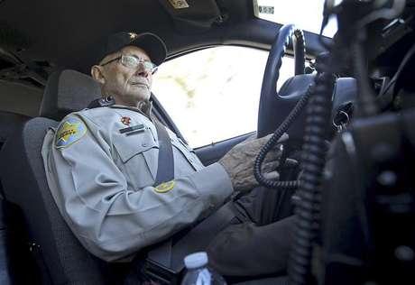 Anthony Monaco, 22, of Phoenix, Arizona, a member of the volunteer posse, drives around Boulder Creek High School in Anthem, Arizona, January 9, 2013.