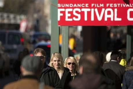 Pedestrians walk down Main street during the Sundance Film Festival in Park City, Utah, January 20, 2013.