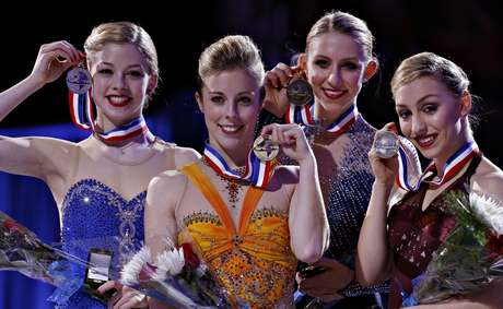 First place Ashley Wagner (C) is flanked by second place Gracie Gold (L) third place Agnes Zawadzki and fourth place Courtney Hicks (R) in the Ladies competition at the U.S. Figure Skating Championships in Omaha, Nebraska, January 26, 2013.  REUTERS/Jim Young  (UNITED STATES - Tags: SPORT FIGURE SKATING)