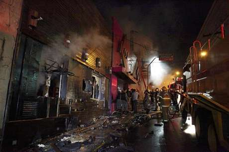 Fire-fighters try to extinguish a fire at Kiss nightclub in the southern city of Santa Maria, 187 miles (301 km) west of the state capital of Porto Alegre, in this picture taken by Agencia RBS, January 27, 2013.