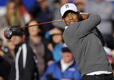 "<font color=""#ff0000"">Tiger</font> <font color=""red"">Woods</font> watches the flight of his drive on the first hole as he begins fourth round of the Farmers Insurance Open golf tournament, Sunday, Jan. 27, 2013, in San Diego."