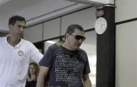 Mauro Hoffman (R), who is one of the owners of the Boate Kiss nightclub, is pictured after turning himself in at the police station in the southern city of Santa Maria, 187 miles (301 km) west of the state capital Porto Alegre, January 28, 2013.