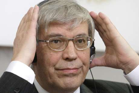 Russian Central Bank head Sergei Ignatyev adjusts his headphones during a news conference in Vienna in this file photo taken March 12, 2009.