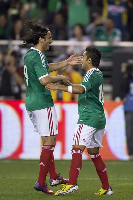 Aldo Di Nigris (left) and Marco Fabian celebrate after Fabian scored on a penalty kick in a 1-1 draw for Mexico against Denmark.