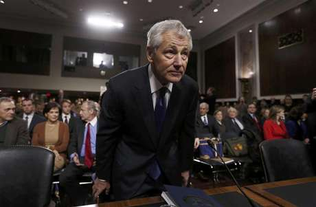 Former Sen. Chuck Hagel (R-NE) (L), sits down before giving testimony to the Senate Armed Services Committee to be Defense Secretary, on Capitol Hill in Washington, January 31, 2013. Hagel, 66, is a decorated Vietnam War veteran and a former two-term Republican senator.