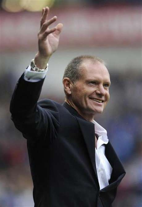 Ex-Rangers' player Paul Gascoigne reacts to the supporters' reception for him at half time during their Scottish Premier League soccer match against St Mirren at Ibrox Stadium, Glasgow, Scotland October 15, 2011.