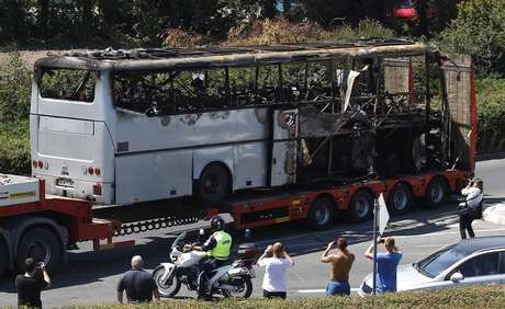 A truck carries a bus, that was damaged in a bomb blast on Wednesday, outside Burgas Airport, about 400km (248miles) east of Sofia July 19, 2012.