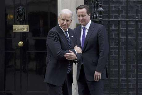 Britain's Prime Minister David Cameron (R) bids farewell to U.S. Vice President Joe Biden at Number 10 Downing Street in London February 5, 2013.