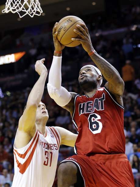 "<p><font color=""red"">Miami</font> <font color=""red"">Heat</font> forward LeBron James (6) shoots against Houston Rockets center Cole Aldrich (31) during the first half of an NBA basketball game, Wednesday, Feb. 6, 2013, in <font color=""red"">Miami</font>.</p>"