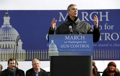 Secretary of Education Arne Duncan addresses the March on Washington for Gun Control on the National Mall in Washington, January 26, 2013.