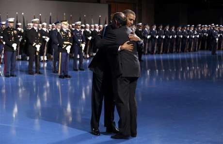 President Barack Obama hugs Defense Secretary Leon Panetta during the Armed Forces Farewell Tribute to Panetta at Joint Base Myer-Henderson in Washington February 8, 2013.