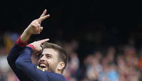<p>Barcelona's Gerard Pique celebrates.</p>
