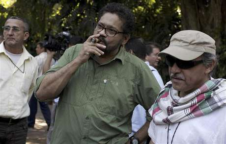 "Revolutionary Armed Forces of Colombia's (FARC) lead negotiator Ivan Marquez smokes a Cohiba cigar next to FARC negotiator Jesus Santrich (R) after a conference in Havana February 10, 2013. Colombia and the Marxist FARC rebels said on Sunday their talks aimed at ending half a century of conflict are picking up pace and making progress towards an agreement on land reform, a key point in the peace process. Speaking as they ended their latest round of negotiations in the Cuban capital, they signalled that public acrimony they had displayed in recent weeks did not represent what was happening behind closed doors. Rodrigo Granda, a senior leader of the FARC, said the discussions were moving ahead on the ""right track"" and ""at the speed of a bullet train."""