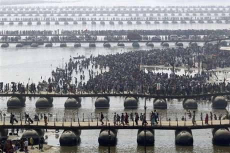 "Hindu devotees cross the river Ganges on pontoon bridges after bathing in the waters at Sangam - the confluence of the Ganges, Yamuna and mythical Saraswati rivers - after the second ""Shahi Snan"" (grand bath), during the ongoing ""Kumbh Mela"" or Pitcher Festival in the northern Indian city of Allahabad February 10, 2013."